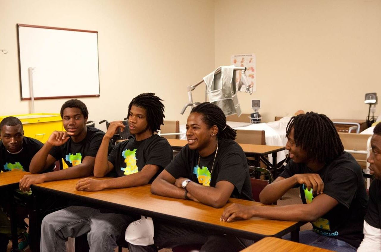 Youth sitting at the table with black tshirts